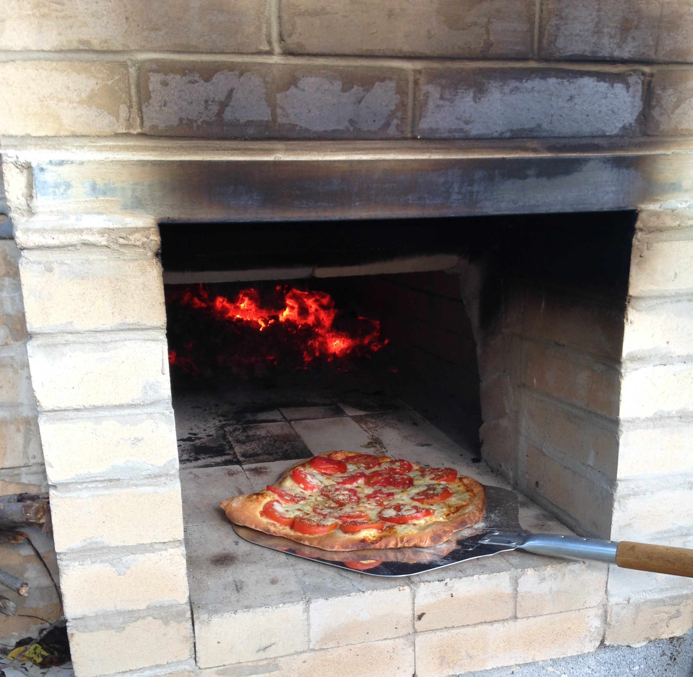 Cooking brick oven pizza.
